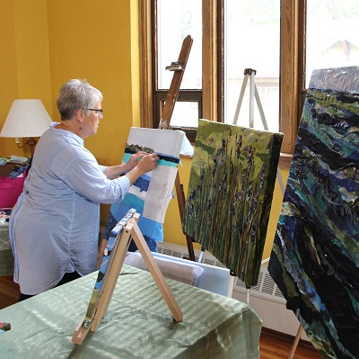 Local artist Pam Collins demonstrates Fabric Painting.