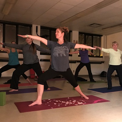 A yoga class being held at the Staples Community Center.