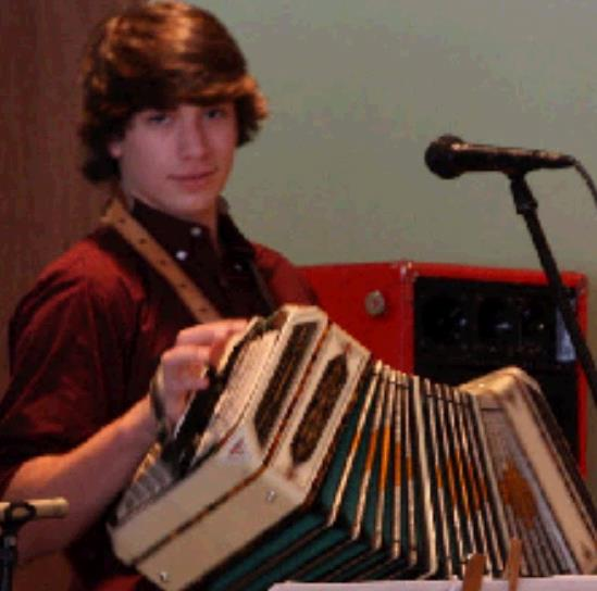 Nathan Neuman playing his accordian.