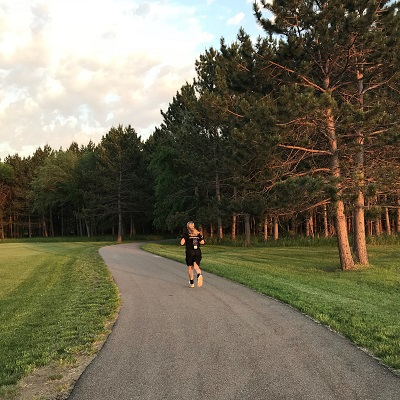 A woman runs on the Legacy Trail in Staples, MN.