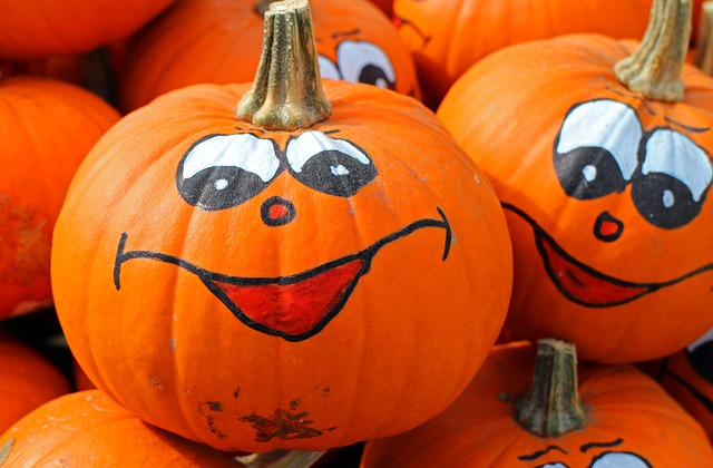 Two pumpkins with silly painted faces