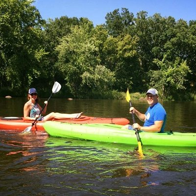 Husband and wife kayak on the Crow Wing River.