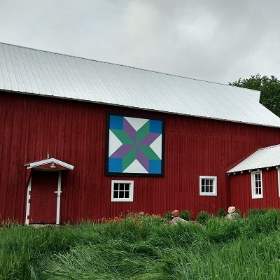 Cube Lattice barn quilt displayed on the side of a barn near Staples, MN.
