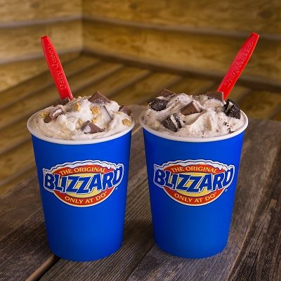 Two Dairy Queen blizzards in blue cups.