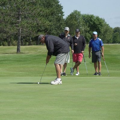 A foursome golfing at The Vintage in Staples, MN.