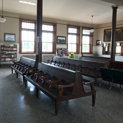 The benches inside the Staples Historic Depot.