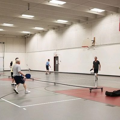 Men's league plays pickleball at the Staples Community Center.