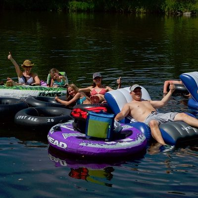 A group of people tube down the Crow Wing River in Staples, MN.
