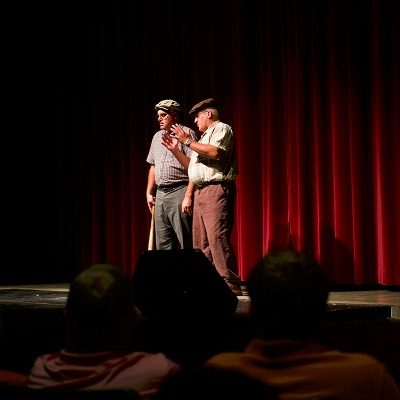 "Two men perform ""Who's on First"" at the Red Caboose Variety Show in 2017."
