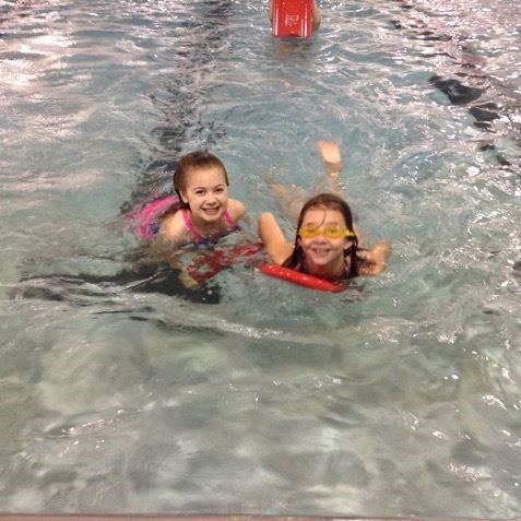 Two girls swimming at the Staples Community Center